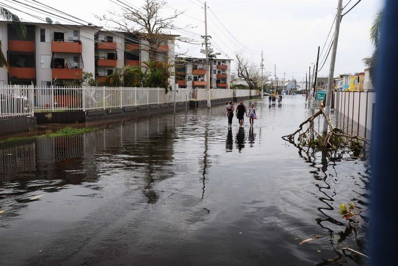 A flooded street in San Juan, Puerto Rico after Hurricane Maria. Photo by US Department of Defense, released to public domain.