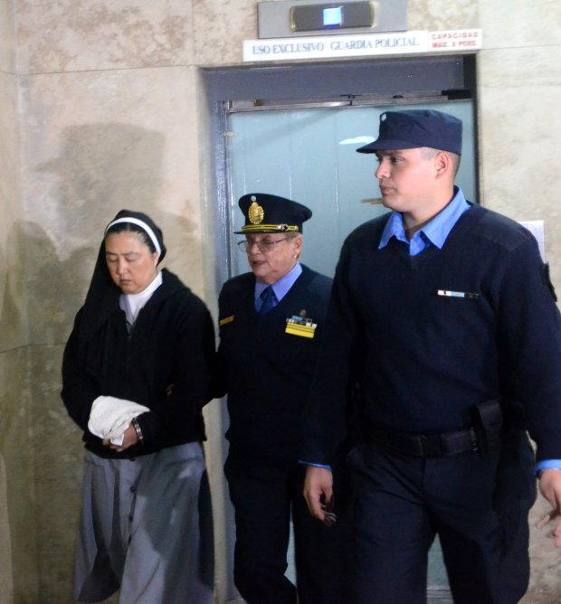 A handout photo made available by the Public Prosecutor's Office of Mendoza on 05 May 2017 shows Kosaka Kumiko, a catholic nun, who was charged by the Prosecutor's Office for her alleged involvement in sexual abuse case against minors at an institute for children with hearing disabilities being escorted to court by police in the Argentine province of Mendoza, Argentina. EPA/NICOLÁS GALUYA HANDOUT BEST QUALITY AVAILABLE HANDOUT EDITORIAL USE ONLY/NO SALES